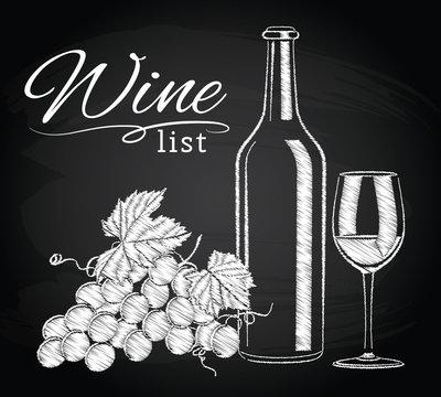 glass, bottle, wine, grapes on chalkboard