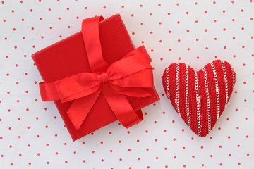 Gift box and heart on polka dot background in vintage style