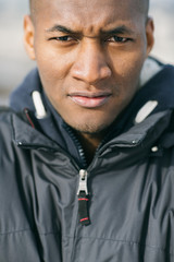 Portrait of a Young Black Man in the Street