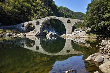 Reflection of The Devil's Bridge and Rhodopes mountain in Arda river, Kardzhali Region, Bulgaria