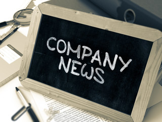 Company News Handwritten on Chalkboard. Composition with Small Chalkboard on Background of Working Table with Ring Binders, Office Supplies, Reports. Blurred Background. Toned Image. 3D Render.