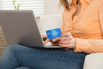 Close-up Of A Woman Shopping On Laptop