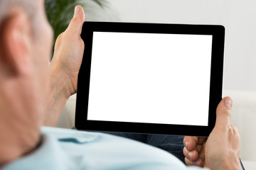 Person Hand Holding Tablet With Blank Screen