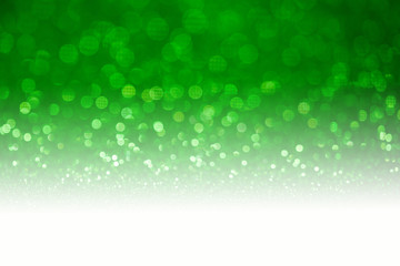 Green glitter surface with green light bokeh with white copyspace