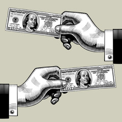 Right and left hands with the 100 dollars bank note