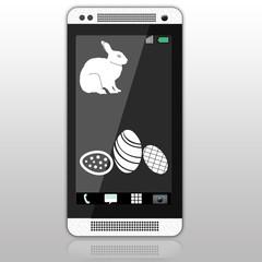 пасхальный смартфон.черно-белый смартфон с заставкой с кроликом и пасхальными яйцами