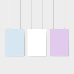 Blank color pages hanging against grey background