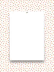 Close-up of one nailed blank frame on orange dots background