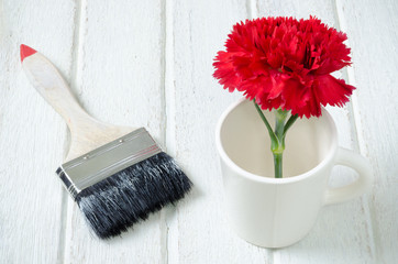 Red Carnation flower with paint brush