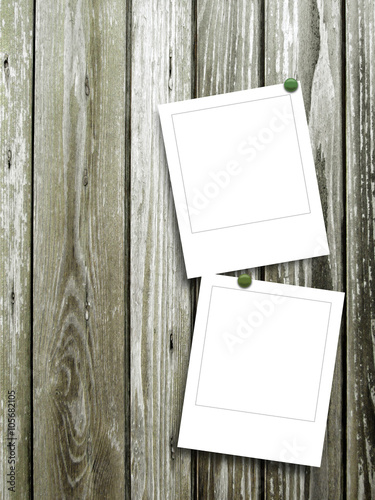 Close Up Of Two Square Blank Photo Frames With Pins On Weathered