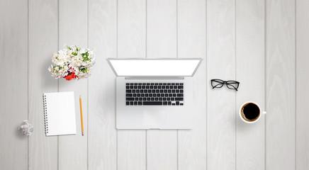 Interior architect work on laptop with isolated display for mock up. Paper, divider, wrinkled paper, glasses, ruler on desk.