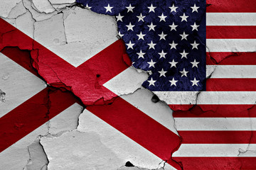 flags of Alabama and USA painted on cracked wall