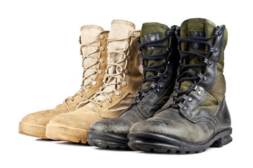 two pairs of army boots isolated on white background