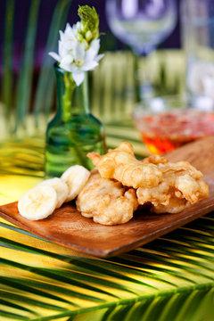 tempura bananas on a wooden plate