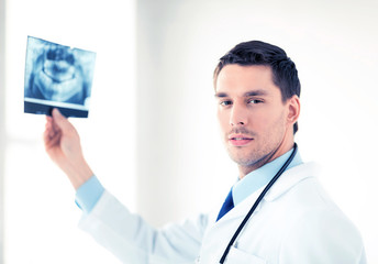 male doctor or dentist with x-ray
