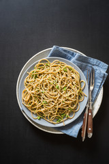 Wholegrain spaghetti with wild garlic and sesame seeds pesto sauce