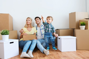 happy family with boxes moving to new home