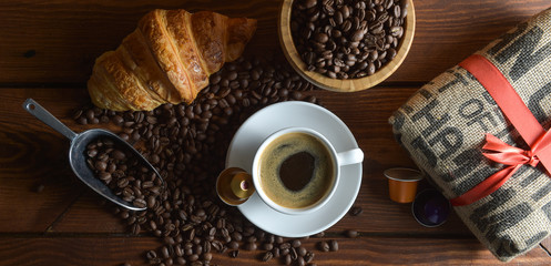 Shot Of Coffee And Croissant On Table