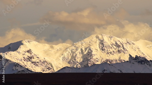 Wall mural Clouds Pass Fast Stormy Skies Alaska Mountains