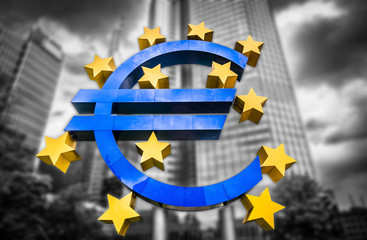 Euro sign with dark clouds symbolizing financial crisis