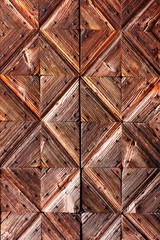 Wooden diamond background of ancient door