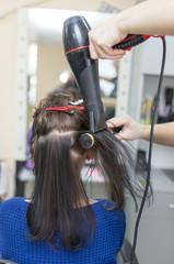 blow-drying in a beauty salon