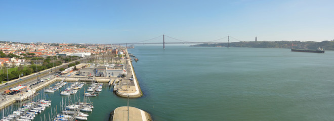 Panorama of Belem marina the river Tejo and the Ponte 25 de Abril  Lisbon Portugal.
