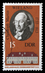 Stamp printed in the DDR (East Germany) shows Christoph Martin Wielandand and his house in Ossmannstedt, circa 1970s