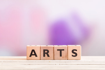 Arts sign on a wooden table