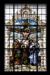 Photo sur Plexiglas Vitrail Crucifixion, Jesus died on the cross, stained glass window in the Basilica of the Sacred Heart of Jesus in Zagreb, Croatia