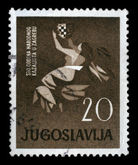 Stamp printed in Yugoslavia dedicated to 100 anniversary of the Croatian National Theatre in Zagreb, circa 1960.