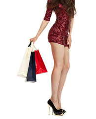 Shopping. Sexy female legs and color bags