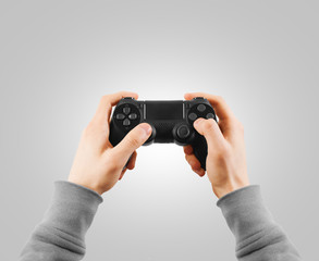 Hand hold new joystick isolated. Gamer play game with gamepad.
