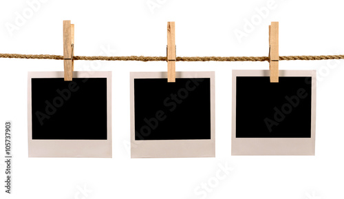 Several blank polaroid style instant photo print frames hanging on ...