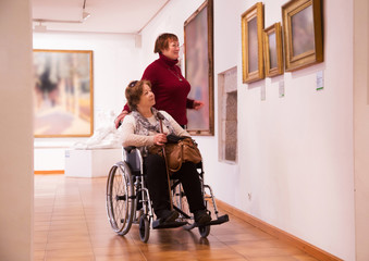 Two woman in art gallery