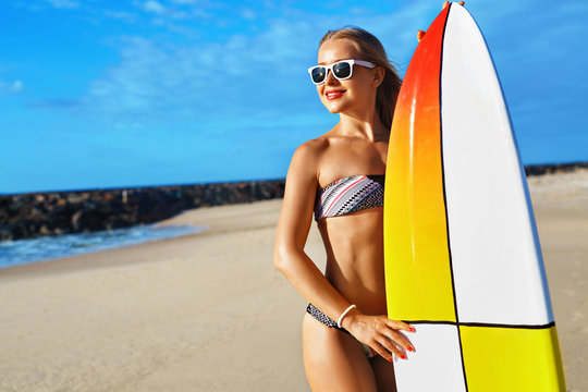 Summer Adventure. Water Sports. Surfing. Sexy Sporty Surfer Girl With Fit Body In Bikini With Surfboard Enjoying Holidays Travel Vacation On Beach. Healthy Active Lifestyle. Leisure Sport. Summertime