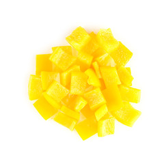 Circular pile of chopped yellow capsicum on white background