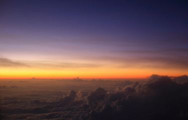 A pre-dawn sky above the clouds over Indonesia taking during a flight at 35,000ft.