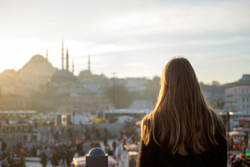 Young girl looks at traveling Mosque in Istanbul Wall mural