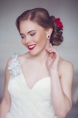 Coiffure of Young Beautiful Attractive Bride with Flowers. White Dress and Wedding Decorations. Vintage Toning
