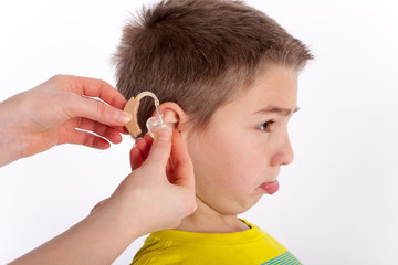 The first hearing aid