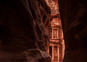 Narrow slot-canyon that serves as the entrance passage to the hidden city of Petra, Jordan. UNESCO World Heritage Site