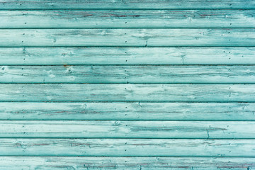 Textured green coloured wooden panelling from a beach hut.  Suitable for background etc.