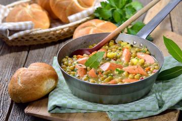 Deftiger Erbseneintopf mit Kartoffeln, Speck und Wiener Würstchen  - Hearty pea stew with potatoes, bacon and Viennese sausages