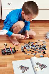 Little boy collects plastic children's designer