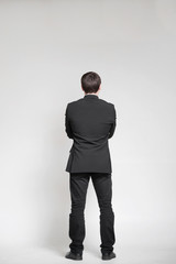 Businessman looking on an empty wall