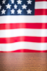 wooden table and usa flag