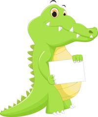 funny crocodile cartoon posing with blank sign