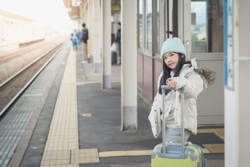 Asian girl waiting for train