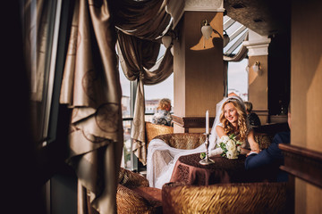 Happy bride and groom in royal vintage interior of restaurant
